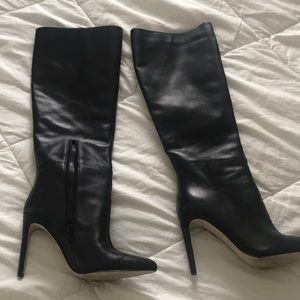 Knee high boots by Guess